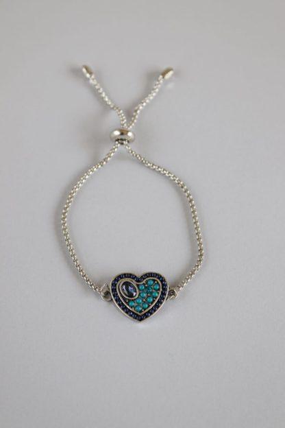 Stone Studded Heart Pendant on Silver Bracelet
